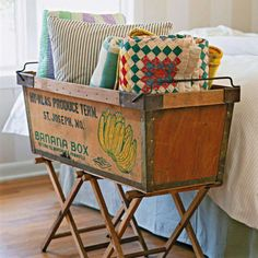 Banana box as quilt/blanket storage. I will be buying one from work pretty soon.
