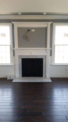 Custom Gas fireplace with RFS surround mantle and over mantle.
