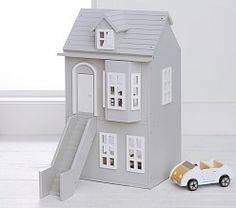 The epitome of style, this gorgeously crafted townhouse is an heirloom piece that your child will cherish for years to come. A dormer and bay window complement the elegant construction, while Northeast Americana tradition lends inspired architectu… Wooden Dollhouse, Wooden Dolls, Dollhouse Furniture, Kids Doll House, Bedroom Accessories, Weathered Wood, Living Room Sets, Pottery Barn Kids, Play Houses