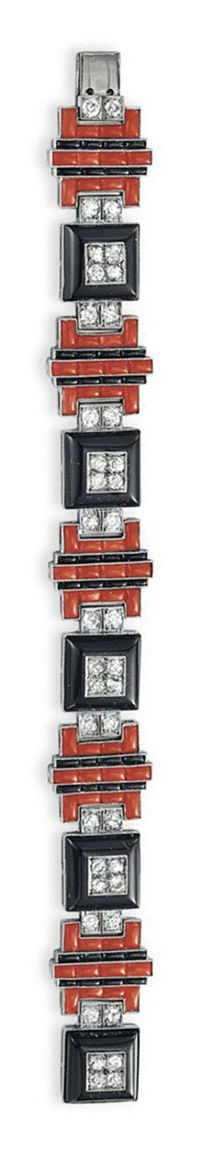 ~A CORAL, ONYX AND DIAMOND BRACELET   mounted in platinum, 6 7/8 ins.  Art Deco or Art Deco style.