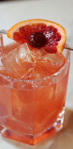 Pomegranate Old-Fashioned | Pomegranate seeds, rye whiskey, bitters, blood orange wheels, and candied cherries