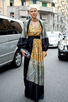 """Elisa Nalin, stylist    """"I'm wearing a Dries Van Noten dress with a necklace and clutch from Lanvin."""""""