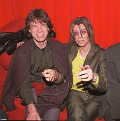 Singers David Bowie (R) and Mick Jagger (L) at POP in Soho, London on December 2, 1999.