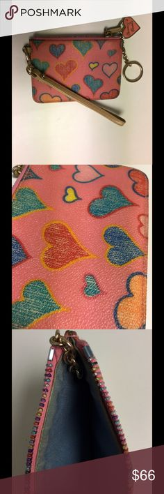 Dooney &Bourke wristlet Colorful, hearts, leather! Rainbow zipper too! Wrist strap is detachable. (Small scratching behind logo on zipper from movement) Dooney & Bourke Accessories