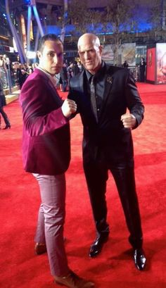 Jaylen Moore (The Peacekeeper) & Bruno Gunn (Brutus) bare their fists on the red carpet at the Los Angeles Premiere of Hunger Games Catching Fire!