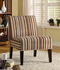 Lifestyle Collection Accent Chair468F7SWhen designing your living space the accent pieces you choose not only to fill the room but allow for the expression of your individual style to come shining through. Offered in a multitude of fabrics and frames, our accent collection will compliment your unique style. Finish:Classic Muli-Colored Stripe FinishFeatures:Lifestyle CollectionContemporary StyleTransitional Style Dimensions:Chair: 22.75 x 29.5 x 32.5Hs.b