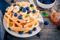 Buy Fresh homemade waffles with blueberries and banana for breakfast by nblxer on PhotoDune. Fresh homemade waffles with blueberries and banana for breakfast on wooden background. Waffles Paleo, Blueberry Waffles, Homemade Waffles, Breakfast Waffles, Breakfast On The Go, Waffle Machine, Banana, Waffle Recipes, Galette
