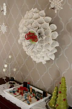 DIY wreath out of rolled up music sheets. A retro Merry Christmas sign adds a vintage touch.