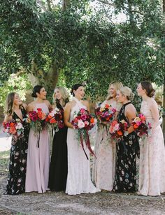 Start with one patterned bridesmaid dress, then pull out the colors in that print to create a scheme for the rest. Patterned Bridesmaid Dresses, Black Bridesmaids, Bridesmaids And Groomsmen, Floral Dresses, Trendy Wedding, Boho Wedding, Wedding Styles, Casual Wedding, Green Wedding