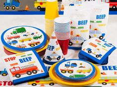 BEEP, BEEP! Move Over And Make Room For Adorable Traffic Jam Party Supplies!Every little boy loves trucks! Celebrate his birthday with this playful party theme featuring various service vehicles. A blue border outlines all of the tableware and decorations, making the assortment of vehicles really stand out on the crisp white background.  Garbage, fire, dump, tow, cement, and monster trucks along with police cars and school buses are all featured on the Traffic Jam party supplies. Brightly…