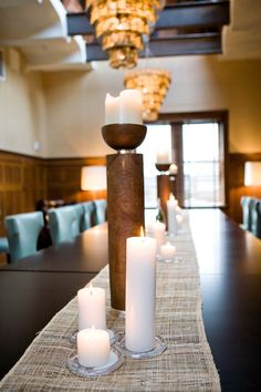 Centerpieces bring up the rooms already-rich tones and textures.