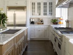 Dark hardwood floors with antique white cabinets... - thenest