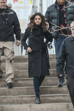 Selena looks classic and elegant in a simple trenchcoat.   - Seventeen.com