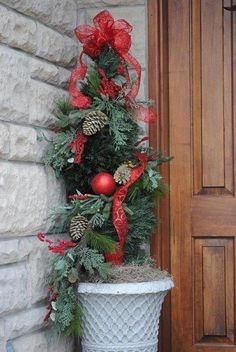 Dress up a an ordinary Christmas tree porch pot.