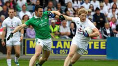 Kildare's Tomas O'Connor shrugs off Stephen Lucey of Limerick during their qualifier at O'Moore Park in Portlaoise