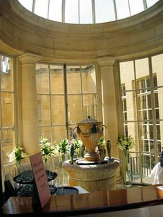 The famous King's Spring Water Fountain in the Pomp Room. Bath, Somerset, ENGLAND.