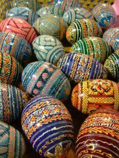 Pysanky are Ukrainian Easter Eggs.Taking a raw egg, the artist uses a special tool with melted wax and adds different lines onto the egg. Then the egg is dipped in dye and left to dry. Repeat with different colors.  Then the wax is melted over a candle and the design is shown through.