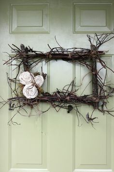 I love the rustic sticks and the delicate roses.