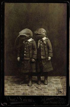 Odd Victorian photo....cat fish head kids O.o