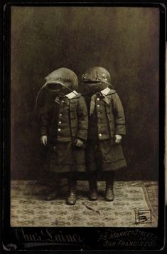 Odd Victorian photo....cat fish head kids O.o