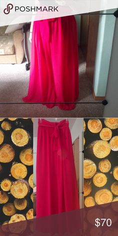 Plus Rose Maxi Skirt Elegant rose pink color chiffon high waisted maxi skirt with beautiful waist tie. Extra long and great to wear with high heels. Big full flowing skirt two layers of chiffon. Will fit XL or XXL.  Under layer 21.5 in long Top layer 47.5 in long Waist 18 in Hips free (60 in circumference) Skirts Maxi
