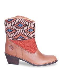 Handmade leather boots for women. A combination of original kilim rugs and premium leather. Shop these beauties at http://www.thekindreds.com #kiboots #thekindred #kindredspirits #boots #patterns #details #patterns #colors #new #shop #fashion #style #gypsystyle #boho #comfortable #shoes #shoesaddict #shoelover