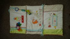 Play mat made from a cot bumper