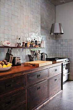 Roddick House Tile Makes the Room | Remodelista. A fully tiled wall in the salvaged kitchen of the Roddick's London home by Maria Speake of Retrouvius.: