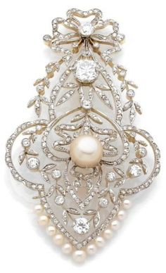 A BELLE EPOQUE, CULTURED PEARL, DIAMOND, PLATINUM AND GOLD PENDENT, CIRCA 1910. Designed as bow, garland, wreath, set with old cut diamonds, centre a cushion cut diamond, cultured pearl, in yellow gold, pearl 10mm, height 8.7 cm, weight 24.4 g More