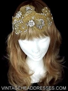 Hand-beaded gold floral headpiece, featuring a trio of 1940's diamante pieces amongst masses of sparkling gold-lined beads and hand-set diamantes. Set onto vintage ivory velvet ribbon, this headpiece ties easily at the back of the head. Boho meets vintage in this gorgeous design.