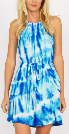 -NEW IN- Blue Crush Dress features a halter neckline and a cool funky tie-dye print. Self tie around the waist for added comfort + bonus front pockets! #new #streetstyle