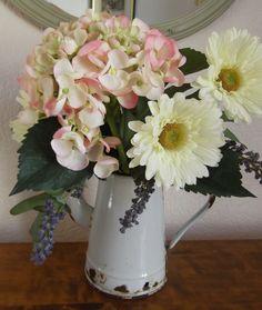 Flowers in an old enamel jug look great