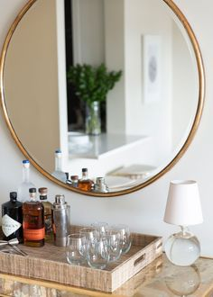 A Designer Spin on Small-Space Living - Home Tour - Lonny | featuring the Tiny Terri Lamp by Thomas O'Brien | TOB3051 Small Space Living, Small Spaces, Round Mirrors, Wall Mirrors, Mirror Hanging, Mirror Tray, Interior Styling, Interior Decorating, Decorating Ideas