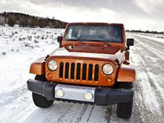 Mango Tango Jeep + Snow = beautiful! Can't wait to do a little bit of this in mine. :-)
