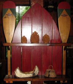 """A Winnipesaukee Canoe Co. Original.This handsome shelf features two decorative Winnipesaukee canoe paddles, painted slat back in the shape of a boat bow and barn board shelves. Hickory twig shelf supports and hand rubbed paint create a great vintage feel.31.5"""" Wide x 38.5"""" High x 7"""" Deep"""