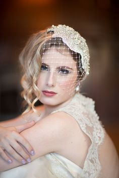 Rhinestone-embellished lace headpiece with a removable English net birdcage veil | Photo by Maru Photography