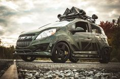 Chevy Spark by Enemy To Fashion. A fledgling fashion house has taken a Chevrolet Spark and turned it into a modern tactical vehicle. Chevrolet Spark, Chevy Vehicles, Army Vehicles, Armored Vehicles, Spark Gt, Chevy Girl, Tuner Cars, Sweet Cars, Modified Cars