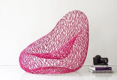 This modern chair is unusual and interesting. Unique chair design and bright pink color make a statement and offer a nice, bold and colorful accent for modern interior decorating. The metal chair is called UOVO Straiato, meaning egg in Italian. Lushome presents this striking chair design idea which