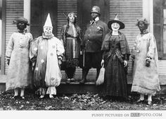 Really scary costumes in old Halloween photo from 1925 looking pretty creepy.