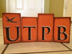 """""""UTPB"""" blocks. Sizes are 4 & 1/2 inches and 4 inches tall. Made of wood and paper. Guaranteed not to fade in the sunlight. Purchase for $10.00, shipping not included. www.blocksitis.com"""