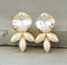 Check out this item in my Etsy shop https://www.etsy.com/il-en/listing/241083625/crysatl-stud-earrings-bridal-pearl