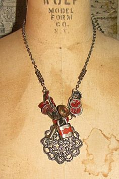 Red Button Necklace. I love the springs in the chain.