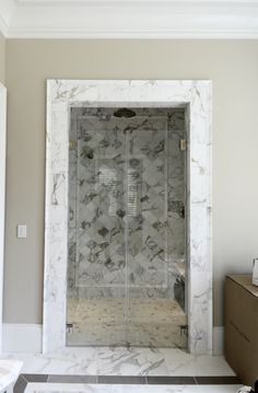 Owings Mills, MD: Enclosed shower in luxurious combination of marble and glass. www.jpaulbuilders.com/?utm_content=buffer77512&utm_medium=social&utm_source=pinterest.com&utm_campaign=buffer   #JpaulBurnside