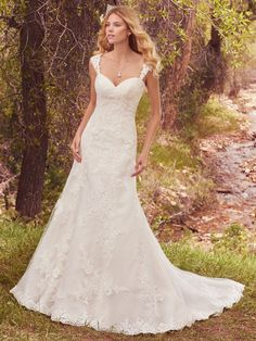 Maggie Sottero - SAMANTHA, A lovely crosshatch-patterned tulle features cascades of lace appliqués in this timeless fit-and-flare, complete with strapless sweetheart neckline and scalloped lace hem. Finished with corset closure, or covered buttons over zipper and inner elastic closure. Detachable cap-sleeves with lace appliqués sold separately.