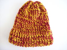 This hat was knit using Red Heart yarn in gold and scarlet on a round loom. I watched a video on Loom-a-Hat and followed the instructions. The colors were inspired by the Hogwarts House of Gryffindor from the Harry Potter series.