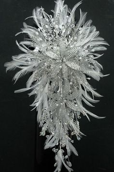 To up the ante, try one of these beaded creations by Divine Floral Designs. This feather and crystal bouquet gives you the look and overall shape of traditional flowers, but it sparkles a whole lot more. Feather Bouquet, Crystal Bouquet, Wedding Brooch Bouquets, Diy Bouquet, Bride Bouquets, Christmas Wedding Bouquets, Cheap Wedding Flowers, Bridal Flowers, Beaded Flowers