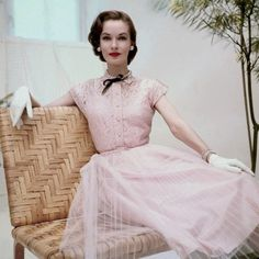 June 1952 Model is wearing a pink cotton lace dress and gloves. Image by ©  Condé Nast Archive Corbis d1428f489