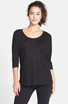 I own this in 2 colors - love it with a pencil skirt or skinny jeans