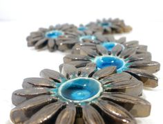 Brown and turquoise ceramic flowers