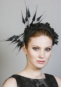 Rachel Trevor Morgan Millinery Spring Summer 2016 R1693 Black lace crescent with flower motifs and arrow feathers